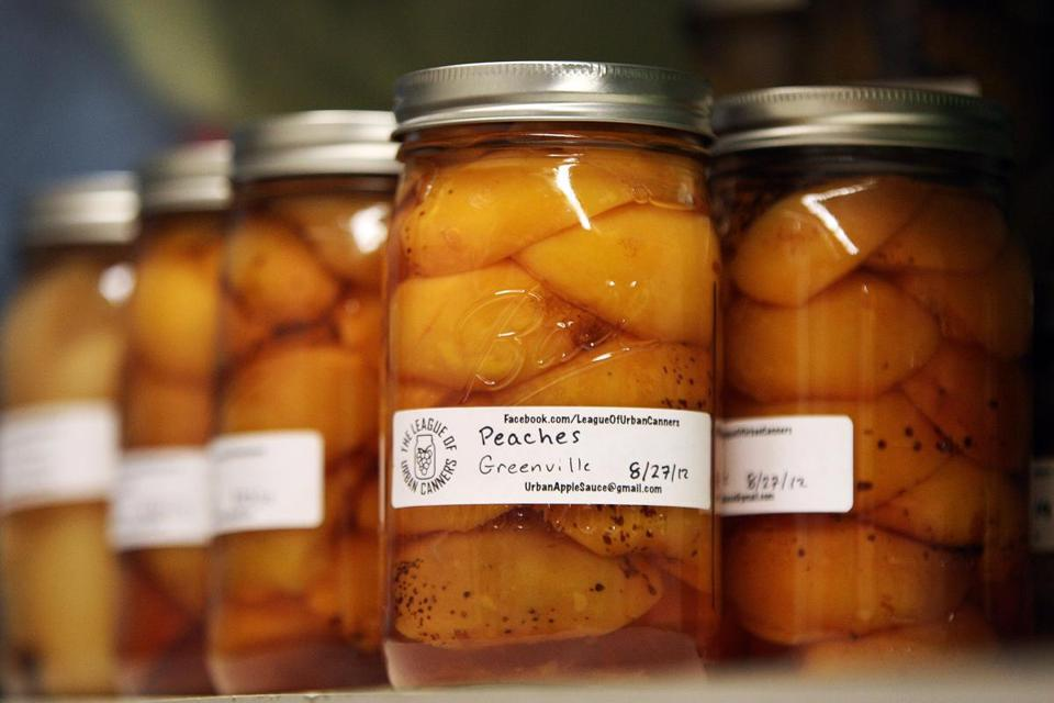 The League of Urban Canners is a new organization devoted to converting oft-neglected fruits from city lots and neighbors' trees into jellies, jams, and preserves, such as the peaches.